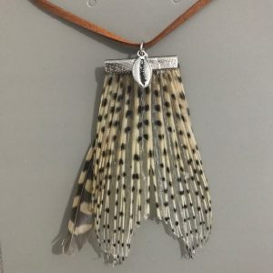 Lionfish pendant with shell and feather